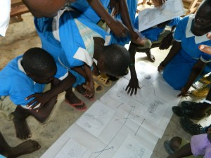 The Water Project : kenya4245-25-using-the-blocking-posters-on-the-f-diagram-2