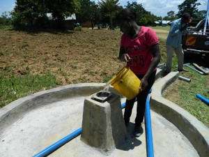 The Water Project : kenya4245-27-chlorinating-the-well-of-lukongo-primary-school-2