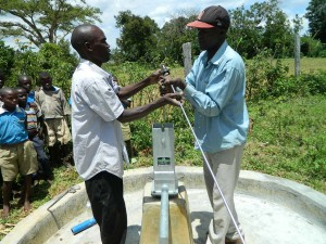 The Water Project : kenya4245-28-installing-the-stainless-steel-rods-2