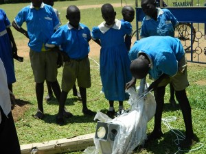 The Water Project : kenya4245-32-a-pupil-uncovers-the-new-pump-2