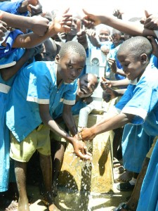The Water Project : kenya4245-34-handing-over-the-rehabilitated-water-source-to-the-pupils-2