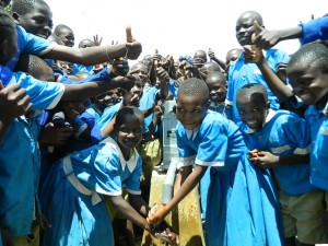 The Water Project : kenya4245-35-handing-over-the-rehabilitated-water-source-to-the-pupils-2