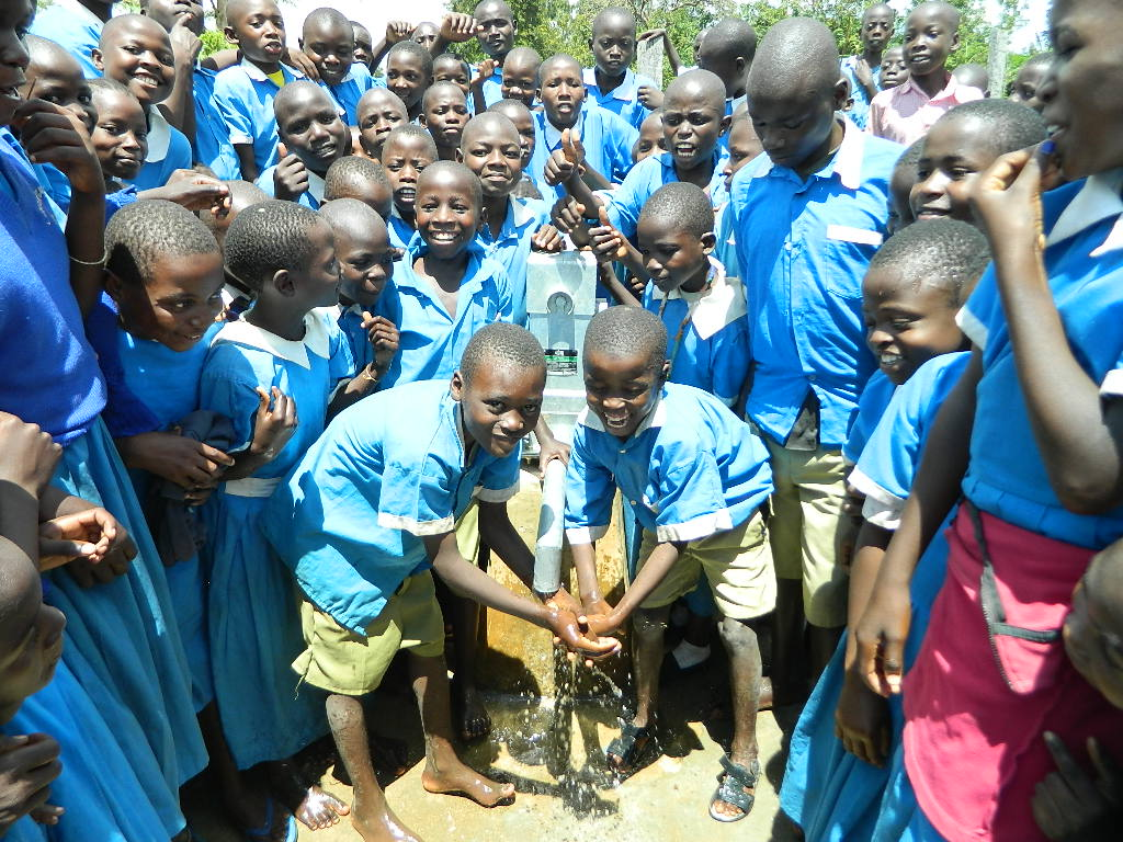 The Water Project : kenya4245-36-handing-over-the-rehabilitated-water-source-to-the-pupils