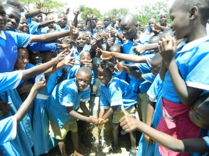 The Water Project : kenya4245-37-handing-over-the-rehabilitated-water-source-to-the-pupils-2