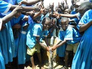 The Water Project : kenya4245-38-handing-over-the-rehabilitated-water-source-to-the-pupils-2