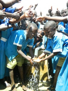 The Water Project : kenya4245-39-handing-over-the-rehabilitated-water-source-of-lukongo-primary-school-to-the-pupils-17-2