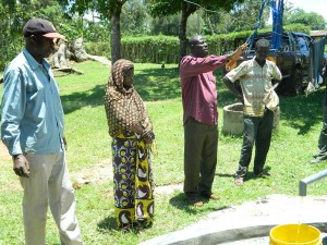 The Water Project : kenya4252-24-bwp-manager-giving-a-speech-before-the-handing-over