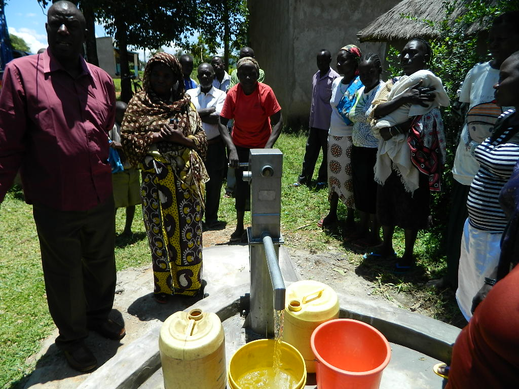 The Water Project : kenya4252-26-water-flowing-after-the-pump-was-installed