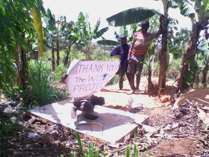 The Water Project : kenya4285-04-a-boy-demonstrating-latrine-use