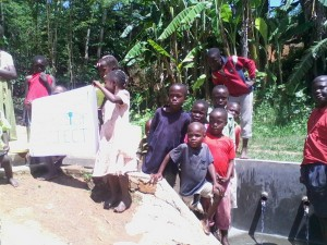 The Water Project : kenya4285-09-children-appreciating-the-work-at-the-spring