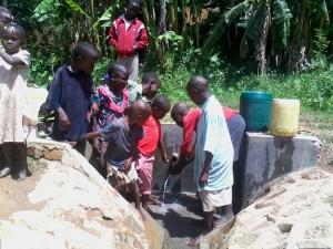 The Water Project : kenya4285-14-children-enjoying-water-at-bweseletse-spring