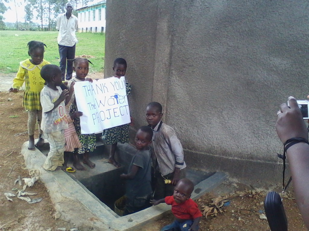 The Water Project : kenya4288-10-children-holding-a-poster-of-appreciation-on-the-work-done