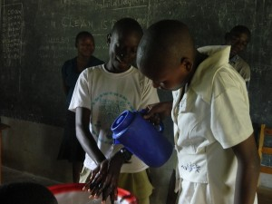 The Water Project : kenya4277-07-ihonje-primary-school-pupils-demonstrating-hand-washing