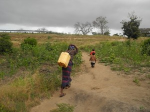 The Water Project : kenya4297-11-members-carry-water-home-on-their-backs