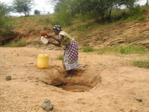 The Water Project : kenya4297-18-members-fetching-water-from-a-scoophole