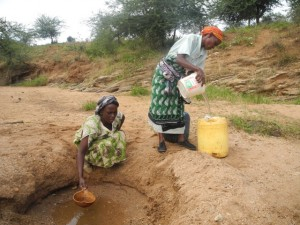 The Water Project : kenya4297-20-members-fetching-water-from-a-scoophole