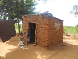 The Water Project : kenya4297-25-second-members-childs-house-and-the-child