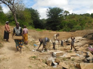 The Water Project : kenya4299-15-members-at-work-at-the-new-dam-site