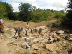 The Water Project : kenya4299-16-members-at-work-at-the-new-dam-site