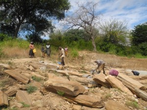 The Water Project : kenya4299-17-members-at-work-at-the-new-dam-site