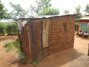 The Water Project : kenya4299-32-second-members-bathroom-behind-a-house