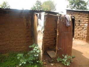 The Water Project : kenya4299-33-second-members-bathroom-behind-a-house