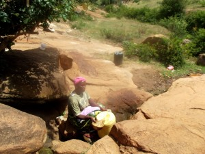 The Water Project : kenya4307-kee-woman-fetching-water-from-a-rock-07