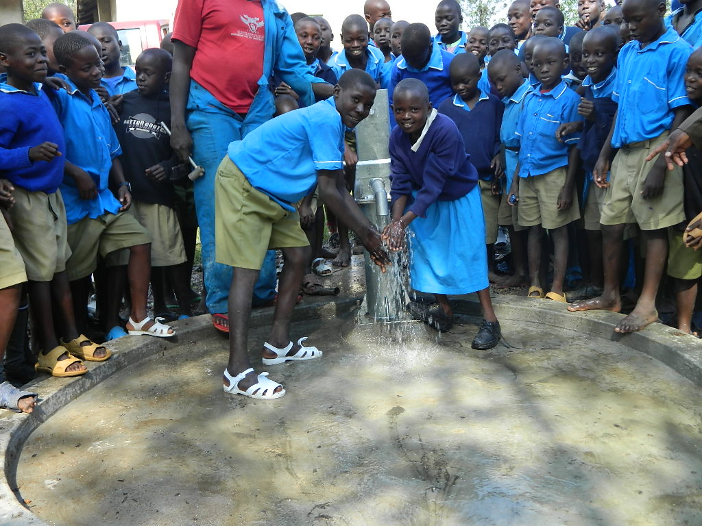 The Water Project : kenya4222-77-handing-over-of-the-emaungu-school-well