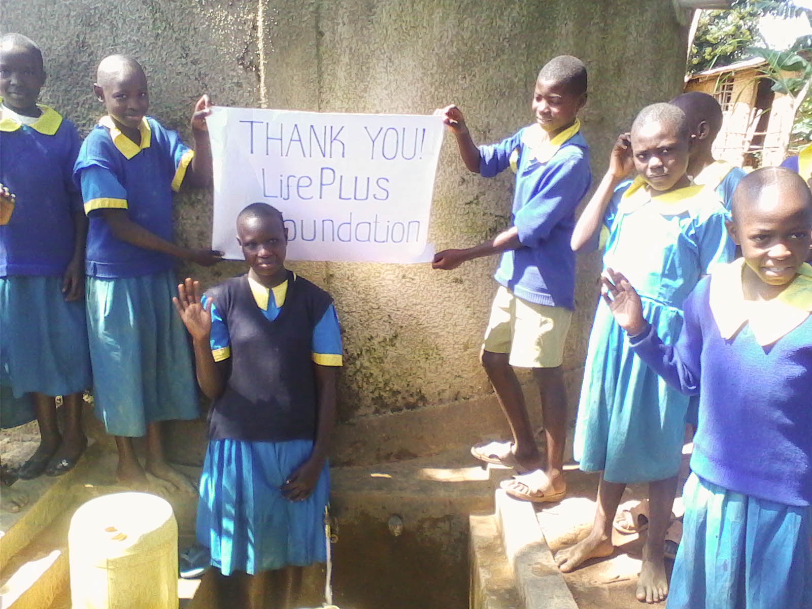 The Water Project : kenya4288-39-shisesia-primary-school-pupils-using-the-constructed-water-tank