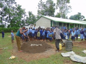 The Water Project : kenya4290-03-artisans-prepairing-materials-for-tank-construction-at-bulanda-primary-school