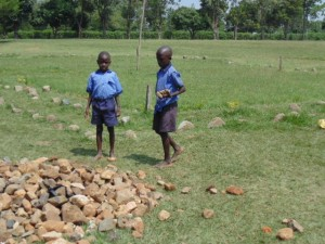 The Water Project : kenya4290-04-boys-of-bulanda-primary-gathering-locally-available-materials-for-tank-construction