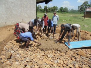 The Water Project : kenya4290-07-director-wewasafo-wash-team-bulanda-headteacher-artisans-and-boys-of-bulanda-primary