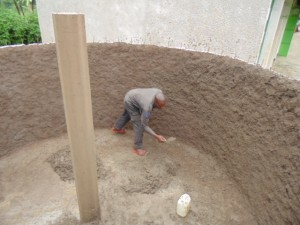 The Water Project : kenya4290-08-gogo-the-artisan-constructing-the-tank-at-bulanda-primary