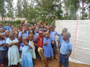 The Water Project : kenya4290-09-pupils-of-bulanda-primary-happy-with-the-progress-of-tank-construction