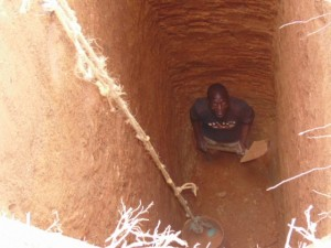 The Water Project : kenya4290-13-atisan-sinking-the-pit-for-vip-latrine-construction-at-bulanda-primary