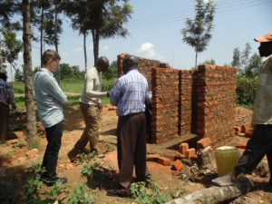 The Water Project : kenya4290-14-director-wash-team-dillon-fron-usa-and-headteacher-during-supervision-at-bulanda-primary-schoo
