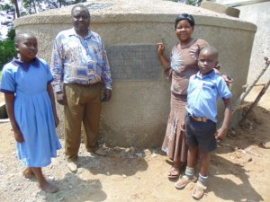 The Water Project : kenya4290-15-headteacher-deputy-headteacher-and-pupils-of-bulanda-primary-posing-for-a-photo-in-front-of-th