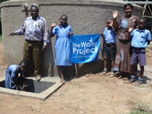 The Water Project : kenya4290-16-headteacher-deputy-headteacher-and-pupils-of-bulanda-primary-posing-for-a-photo-in-front-of-th