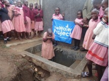 The Water Project : kenya4290-18-bulanda-ps-girls-in-front-of-water-tank