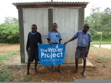 The Water Project : kenya4290-21-bulanda-boys-in-front-of-latrines