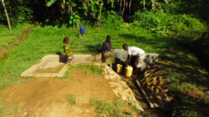 The Water Project : kenya4291-20-comm-members-collecting-water