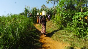 The Water Project : kenya4291-21-community-members-carrying-water-home