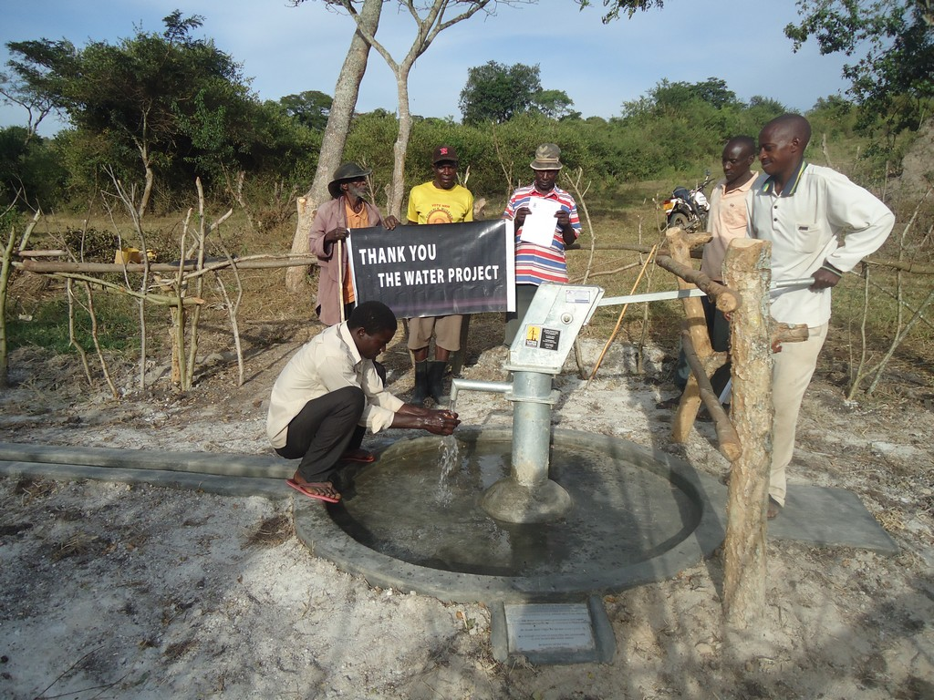 The Water Project : uganda6049-09-some-one-with-clean-water