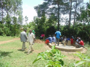 The Water Project : kenya4258-15-eshikulu-community-members-voting-secretly-on-latrine-use