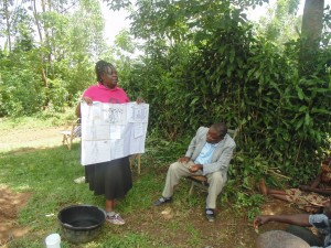 The Water Project : kenya4258-18-janet-of-bwp-explaining-on-the-voting-excersise