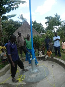 The Water Project : kenya4258-26-installing-the-pipes-to-the-well