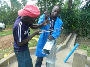 The Water Project : kenya4258-27-installing-the-rods