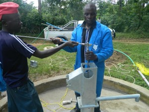 The Water Project : kenya4258-28-installing-the-rods