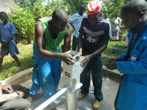 The Water Project : kenya4258-29-pump-head-installation