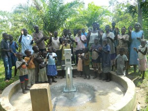 The Water Project : kenya4258-33-eshikulu-members-congratulating-bwp-for-intalling-the-pump-to-their-well